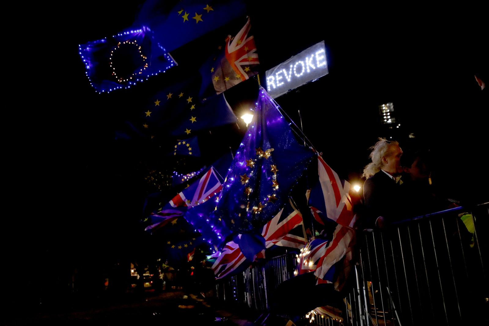 European flags are held by remain in the EU supporters as they demonstrate opposite the Houses of Parliament in London, Wednesday, Sept. 4, 2019.{ } (AP Photo/Matt Dunham)