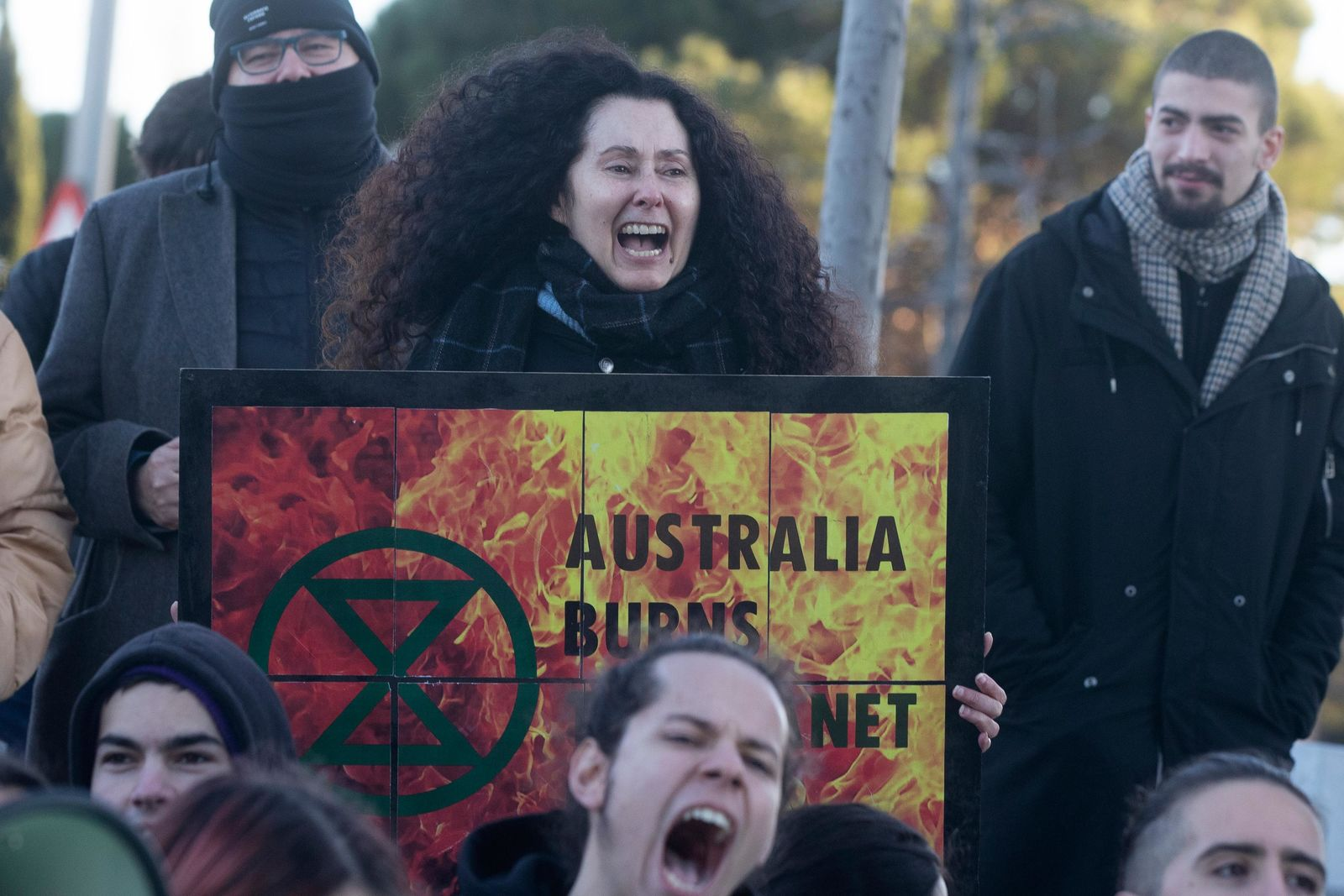 People from the Fridays For Future movement protest outside the Australian Embassy in Madrid, Spain, Friday, Jan.10, 2020.{ } (AP Photo/Paul White)
