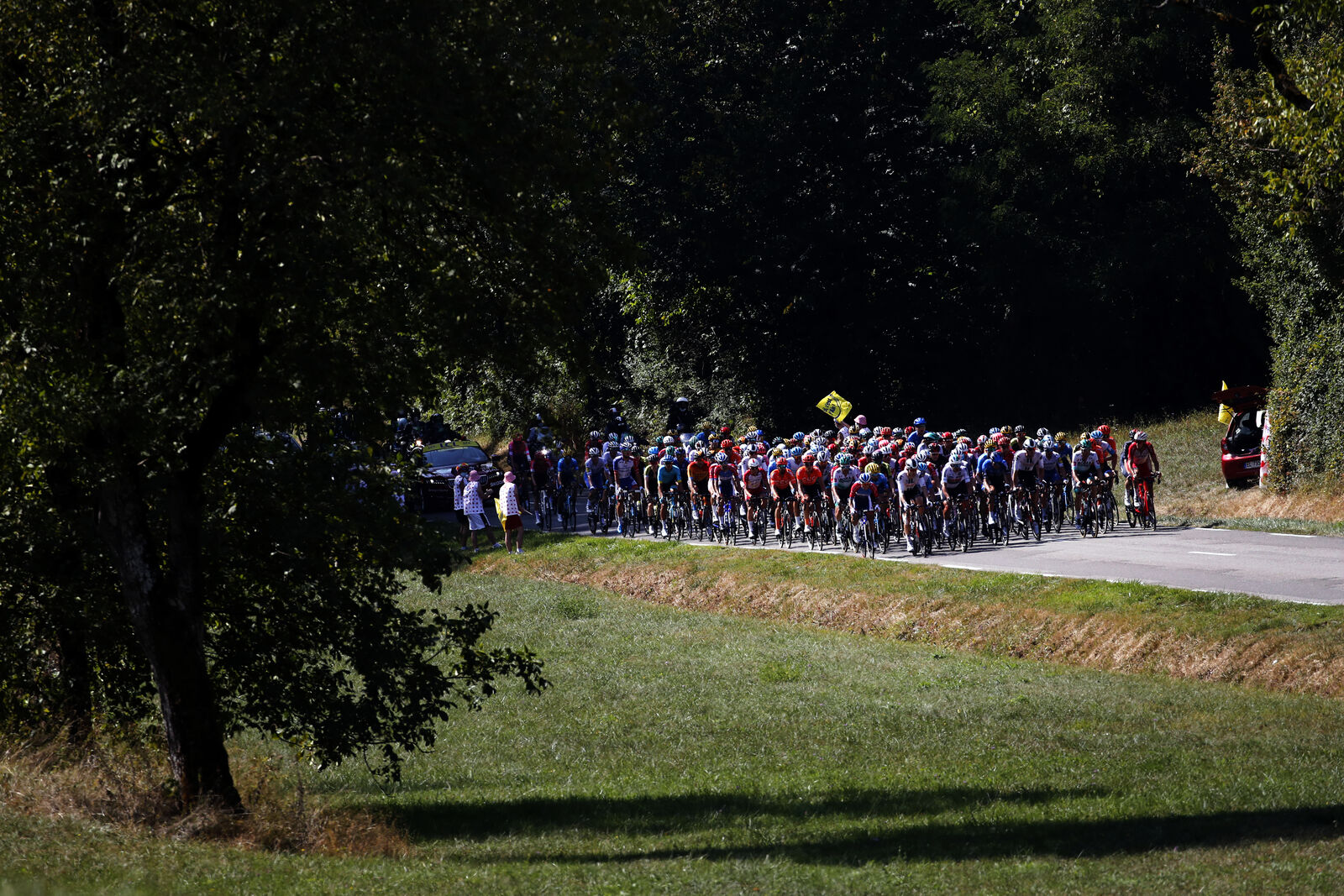 The pack rides during the stage 19 of the Tour de France cycling race over 166 kilometers (103 miles), with start in Bourg-en-Bresse and finish in Champagnole, Friday, Sept. 18, 2020. (AP Photo/Christophe Ena)