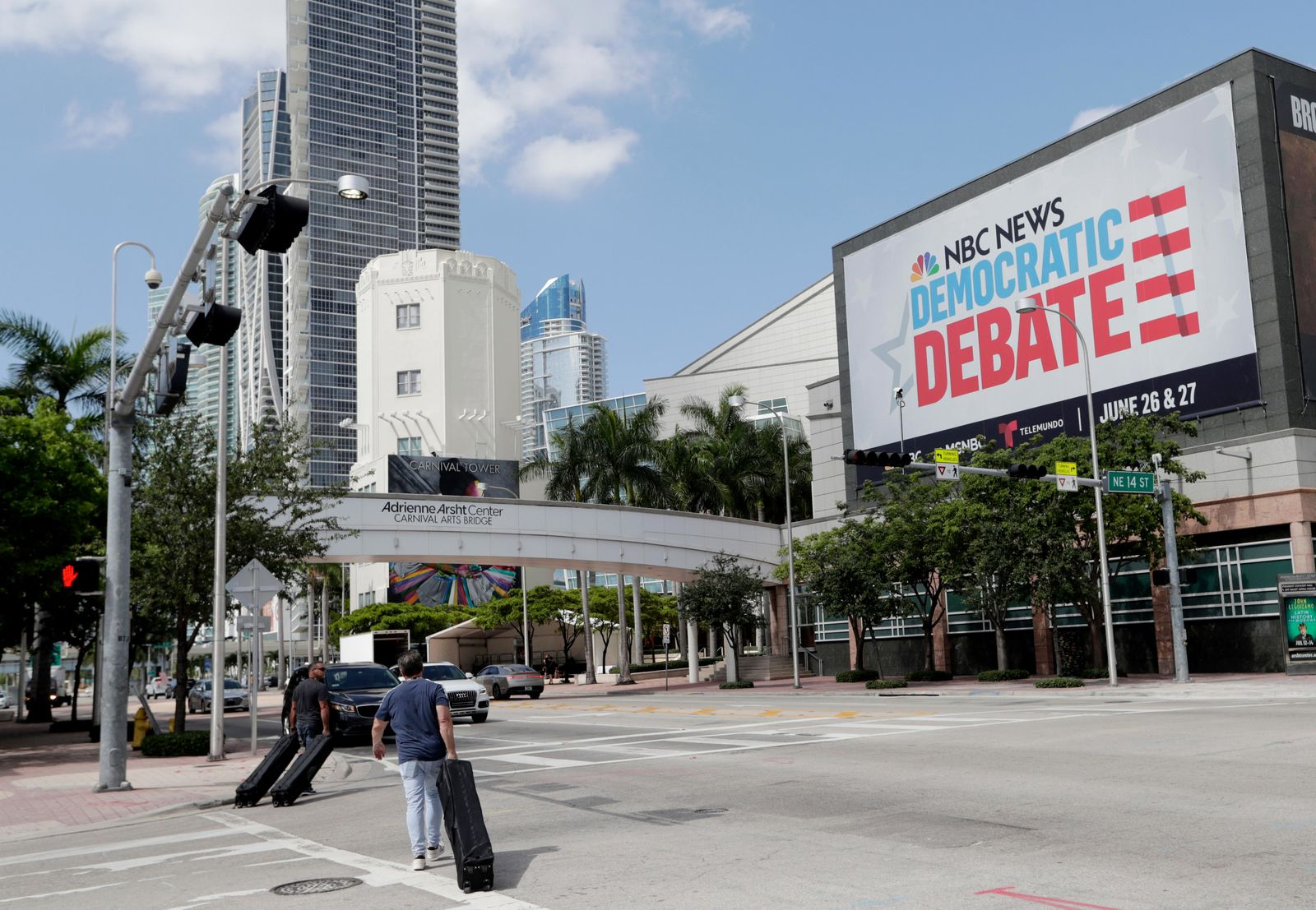 In this June 24, 2019, photo, a billboard advertises the Democratic Presidential Debates across from the Knight Concert Hall at the Adrienne Arsht Center for the Performing Arts of Miami-Dade County, in Miami.{ } (AP Photo/Lynne Sladky)