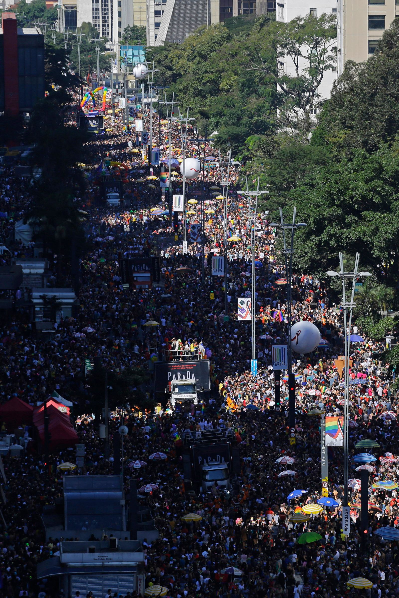 Revelers fill Paulista avenue during the annual gay pride parade in Sao Paulo, Brazil, Sunday, June 23, 2019. (AP Photo/Nelson Antoine)
