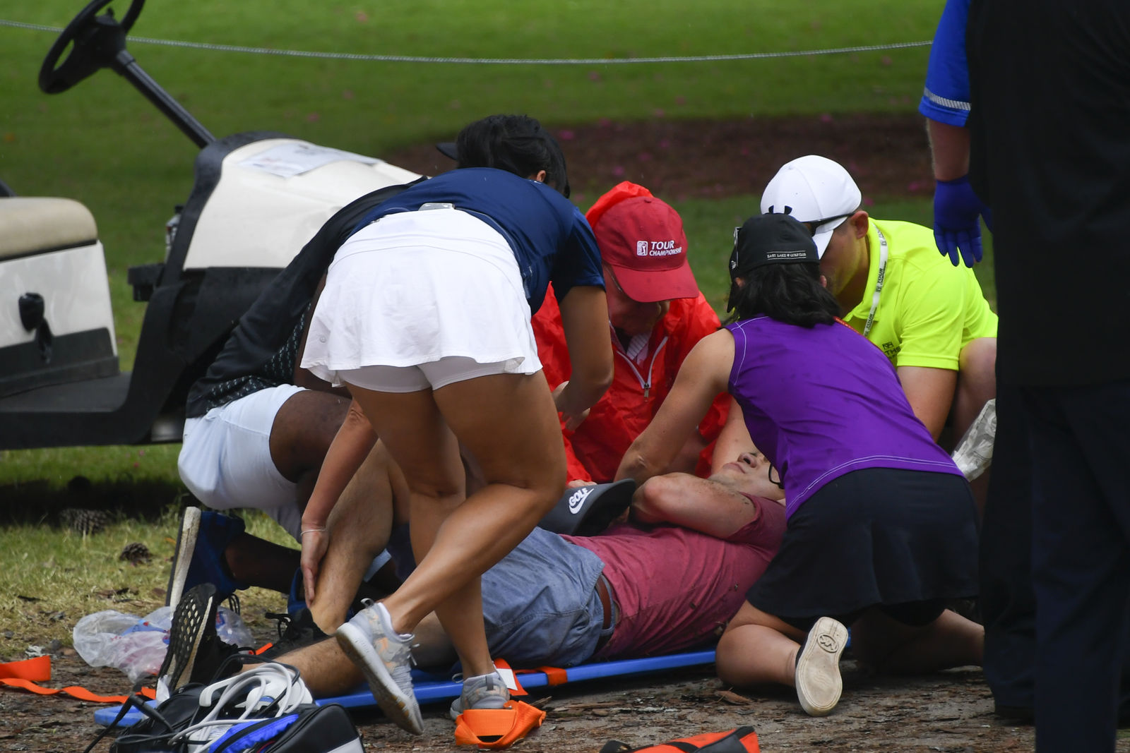A spectators is tended to after a lightning strike on the course which left several injured during a weather delay in the third round of the Tour Championship golf tournament Saturday, Aug. 24, 2019, in Atlanta. (AP Photo/John Amis)