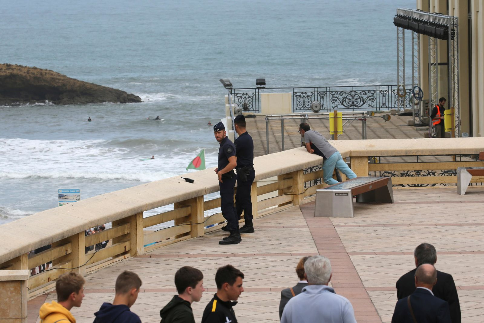 Riot police officers patrol by the municipal Casino, a venue of the upcoming G7 summit, Tuesday, Aug.20, 2019 in Biarritz, southwestern France. French police are setting up checkpoints and combing Atlantic beaches to secure the southwestern coast for world leaders coming for the G-7 summit. (AP Photo/Bob Edme)