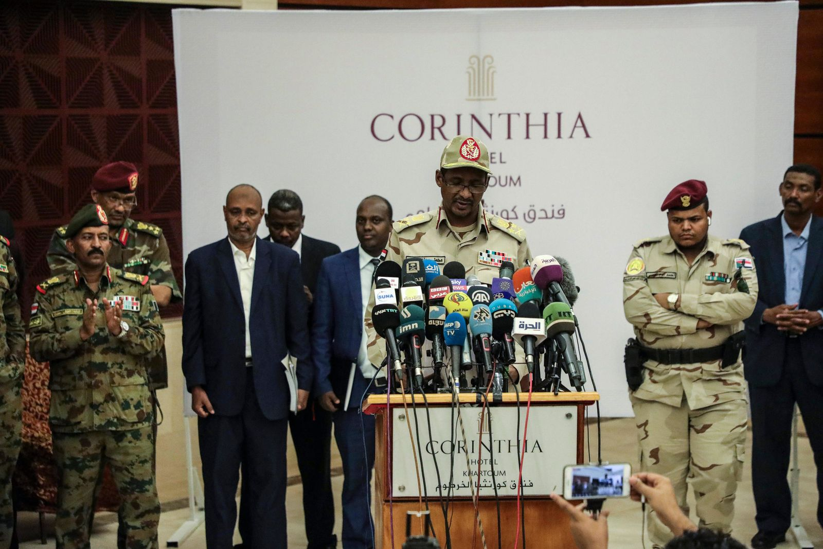 Gen. Mohammed Hamdan Dagalo speaks after signing a power sharing document with Sudan's pro-democracy movement and the ruling military council in Khartoum, Sudan, Wednesday, July 17, 2019.{ } (AP Photo/Mahmoud Hjaj)