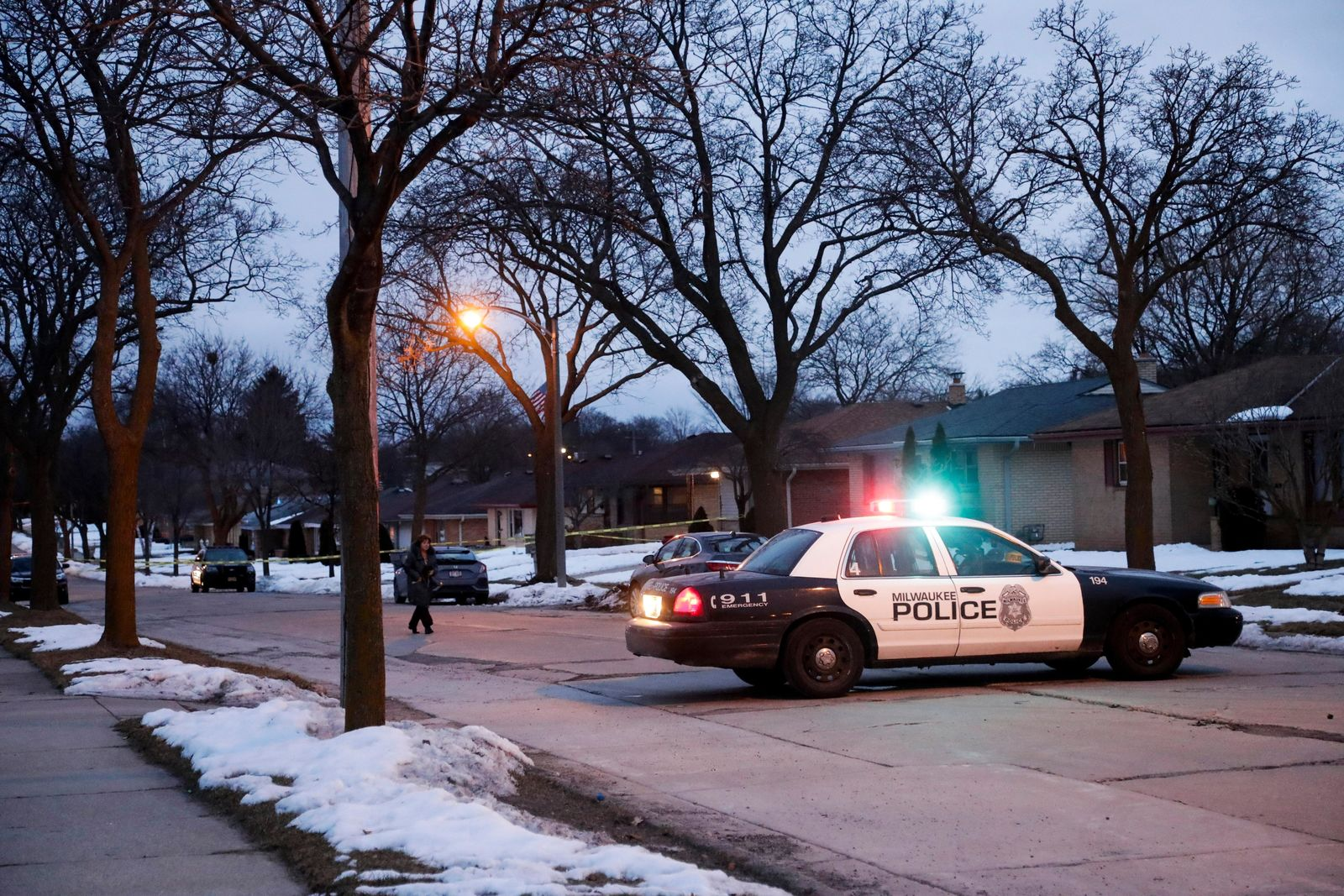 Police are seen outside of a house near Potomac and Courtland after a shooting at Molson Coors, Wednesday Feb. 26, 2020, in Milwaukee. (AP Photo/Morry Gash)