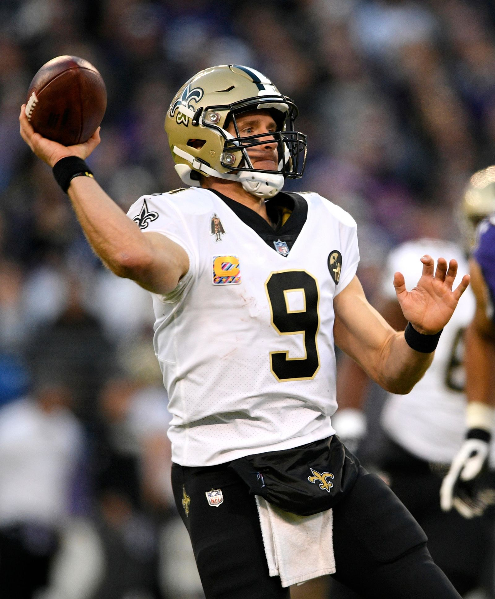 FILE - In this Oct. 21, 2018, file photo, New Orleans Saints quarterback Drew Brees (9) prepares to throw to a receiver in the second half of an NFL football game against the Baltimore Ravens, in Baltimore. The Saints and the Philadelphia Eagles play in a divisional playoff game on Sunday, Jan. 12, 2019. (AP Photo/Nick Wass, File)