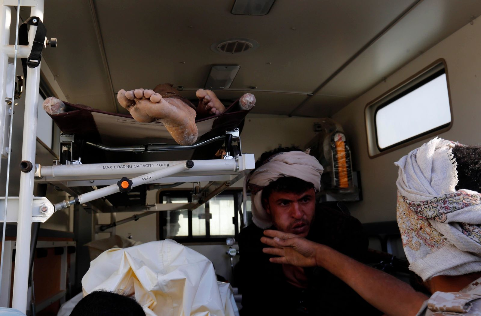 FILE -  In thos Oct. 8, 2016, file, photo, bodies of victims of a Saudi-led coalition airstrike are loaded in an ambulance, in Sanaa, Yemen.{ } (AP Photo/Osamah Abdulrhman, File)