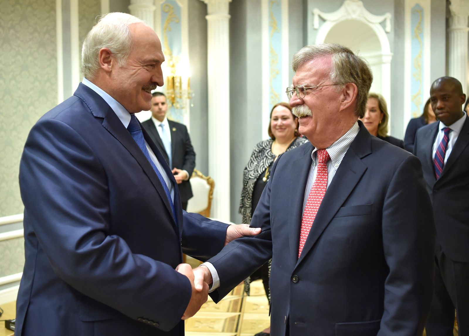 John Bolton, US National Security Advisor, right, is welcomed by Belarusian President Alexander Lukashenko during their meeting in Minsk, Belarus, Thursday, Aug. 29, 2019. (Sergey Gapon/Pool Photo via AP)