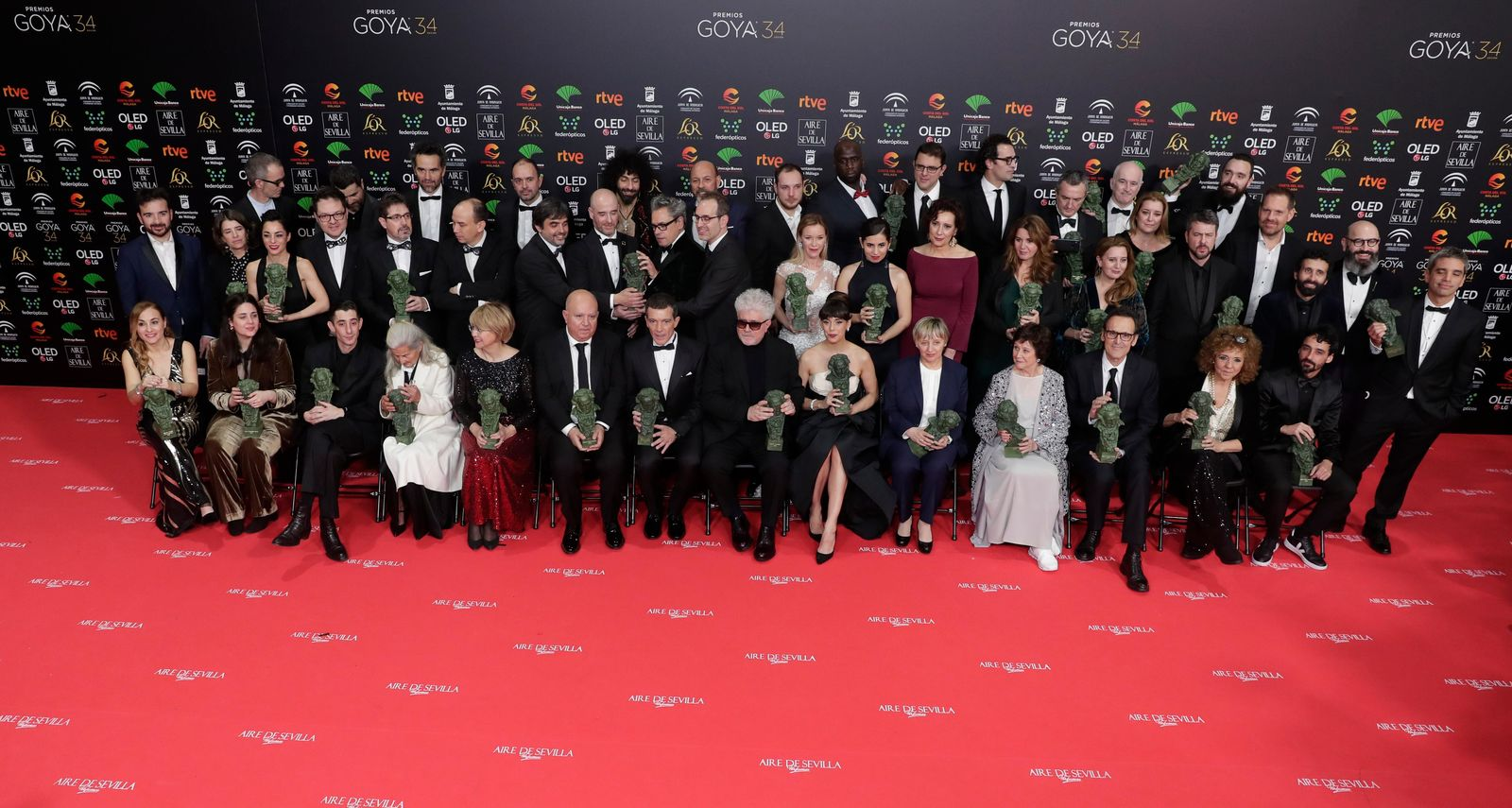 Goya Film Awards winners pose with their trophies for a family photo at the end of the Goya Film Awards Ceremony in Malaga, southern Spain, early Sunday, Jan. 26, 2020. The annual Goya Awards are Spain's main national film awards. (AP Photo/Manu Fernandez)