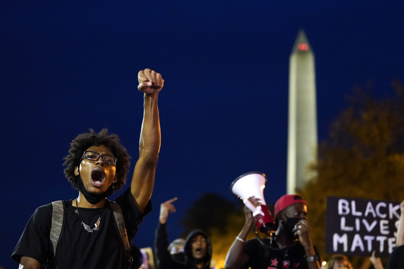 WASHINGTON, DC - SEPTEMBER 23: Demonstrators march near the White House in protest following a Kentucky grand jury decision in the Breonna Taylor case on September 23, 2020 in Washington, DC. A Kentucky grand jury indicted one police officer involved in the shooting of Breonna Taylor with 3 counts of wanton endangerment. No officers were indicted on charges in connection to Taylor's death. (Photo by Drew Angerer/Getty Images)