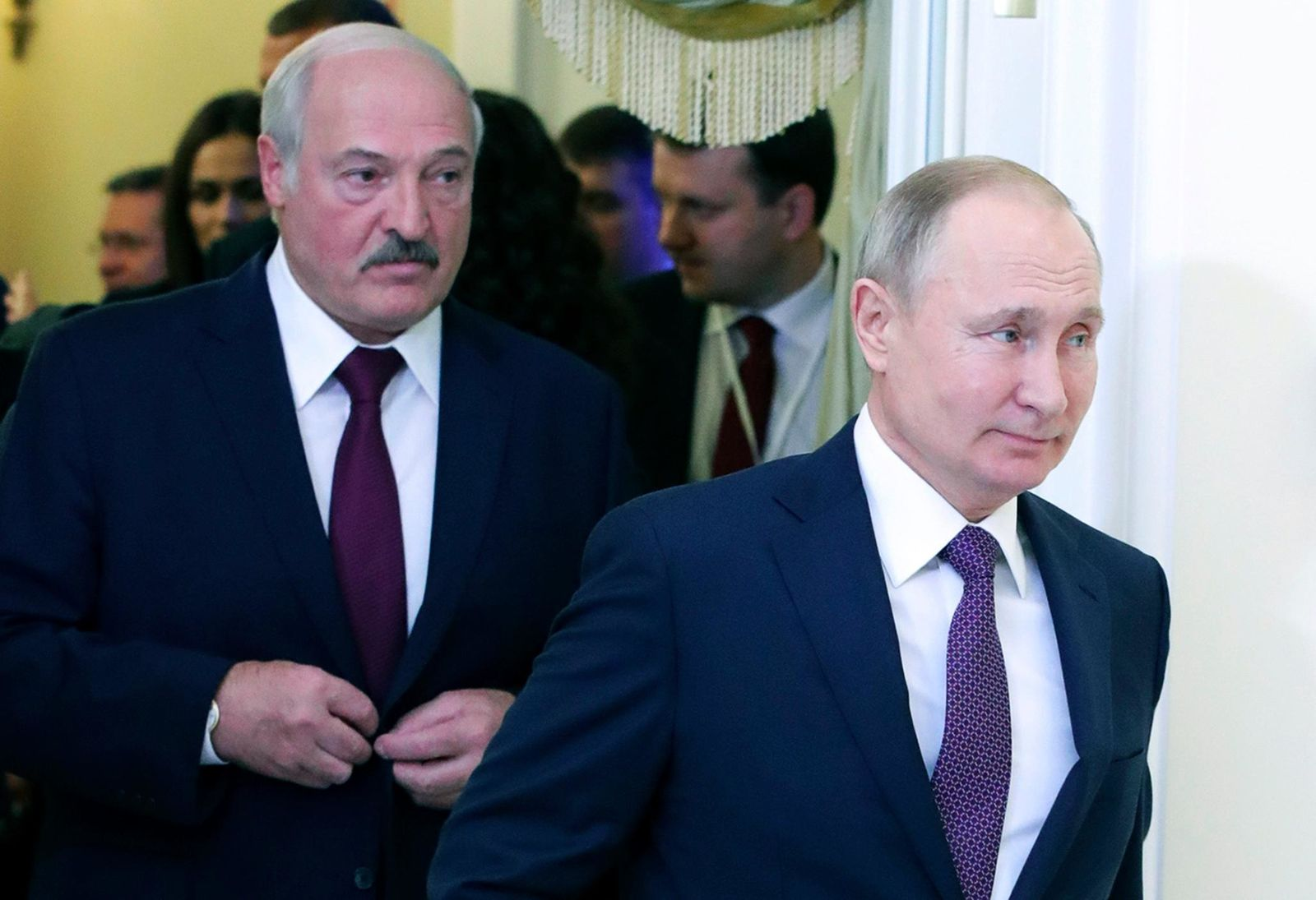 FILE In this file photo taken on Friday, Dec. 20, 2019, Russian President Vladimir Putin, right, and Belarusian President Alexander Lukashenko walk before a meeting of the Supreme Eurasian Economic Council in St. Petersburg, Russia. (Mikhail Klimentyev, Sputnik, Kremlin Pool Photo via AP, File)