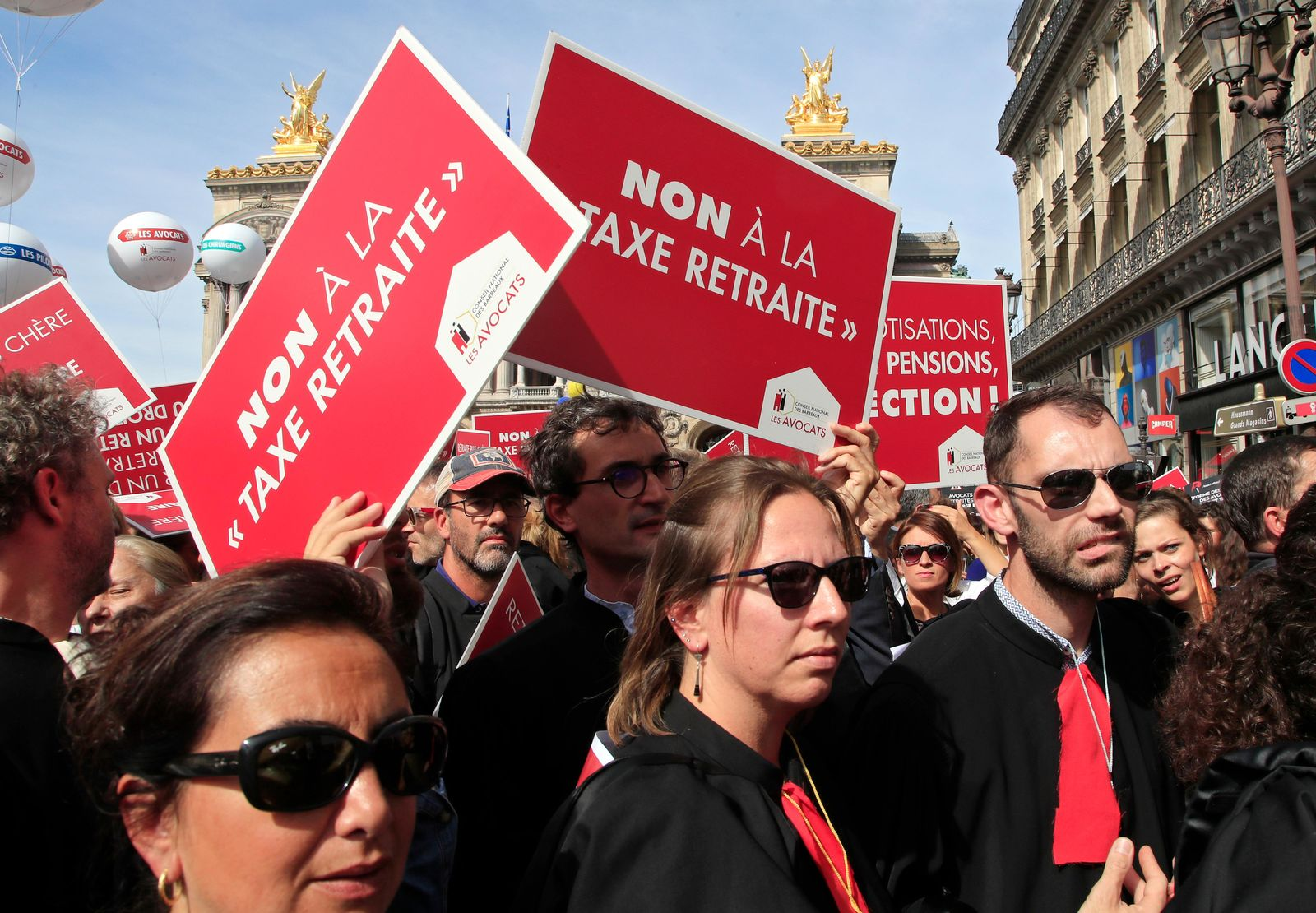 "Lawyers march during a protest against the planned pension change in Paris, Monday, Sept. 16, 2019. French lawyers, doctors, nurses, pilots and others are taking to the streets of Paris to protest planned pension changes by French President Emmanuel Macron's government. Placard read, ""no to the pension tax"". (AP Photo/Michel Euler)"