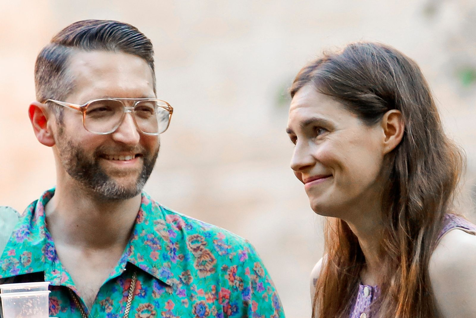 Amanda Knox, right, and her boyfriend Christopher Robinson attend a cocktail for the opening of the Innocence Project conference, in Modena, Italy, Thursday, June 13, 2019. (AP Photo/Antonio Calanni)(AP Photo/Antonio Calanni)