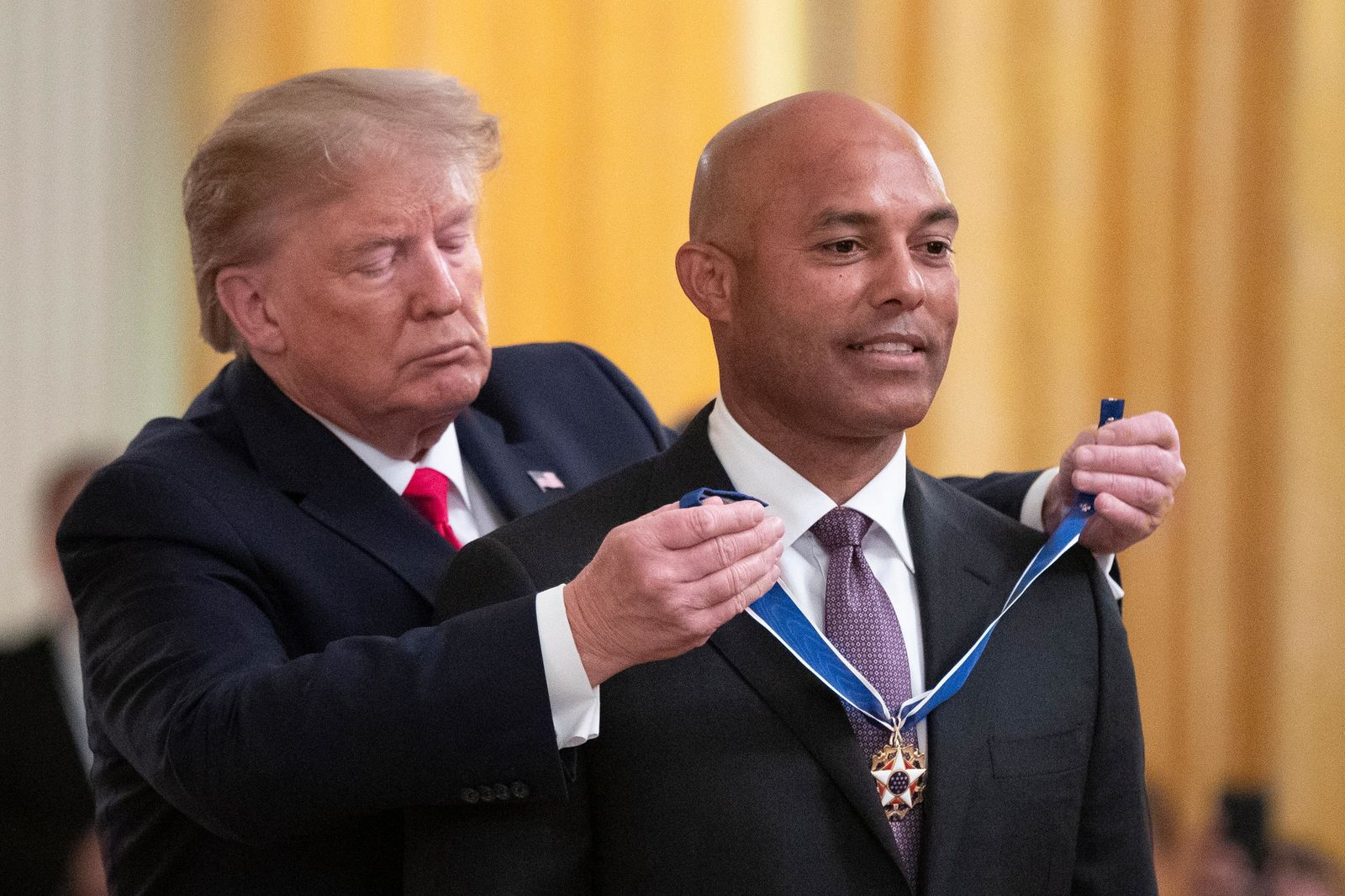 President Donald Trump presents the Presidential Medal of Freedom to former New York Yankees baseball pitcher Mariano Rivera, in the East Room of the White House, Monday, Sept. 16, 2019, in Washington. (AP Photo/Manuel Balce Ceneta)