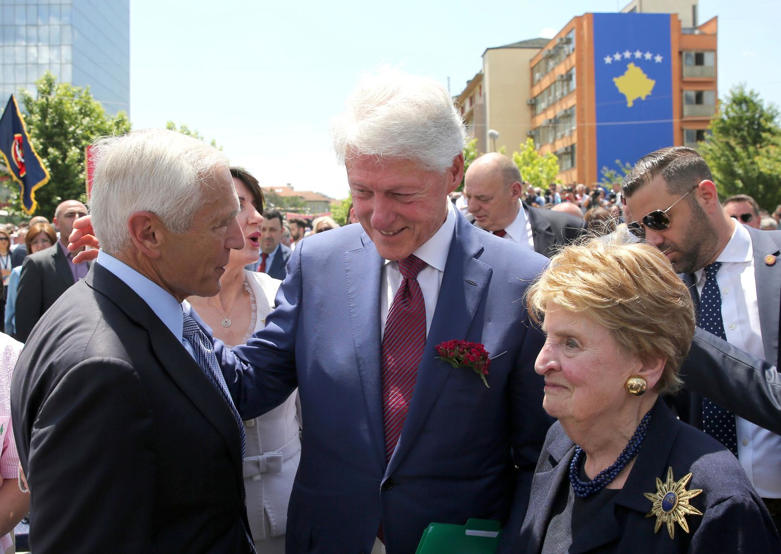 Former U.S. President Bill Clinton, center, speaks with ex-Secretary of State Madeleine Albright, right, and then-NATO commander Wesley Clark during anniversary celebrations in the capital Pristina, Kosovo, Wednesday, June 12, 2019. It's exactly 20 years since NATO forces set foot in the former Yugoslav province, after an allied bombing campaign ended Serbia's bloody crackdown on an insurrection by the majority ethnic Albanian population in Kosovo _ revered by Serbs as their historic and religious heartland. (AP Photo/Visar Kryeziu)