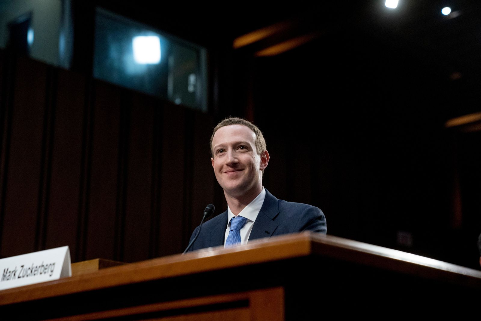 Facebook CEO Mark Zuckerberg smiles while testifying before a joint hearing of the Commerce and Judiciary Committees on Capitol Hill in Washington, Tuesday, April 10, 2018, about the use of Facebook data to target American voters in the 2016 election. (AP Photo/Andrew Harnik)