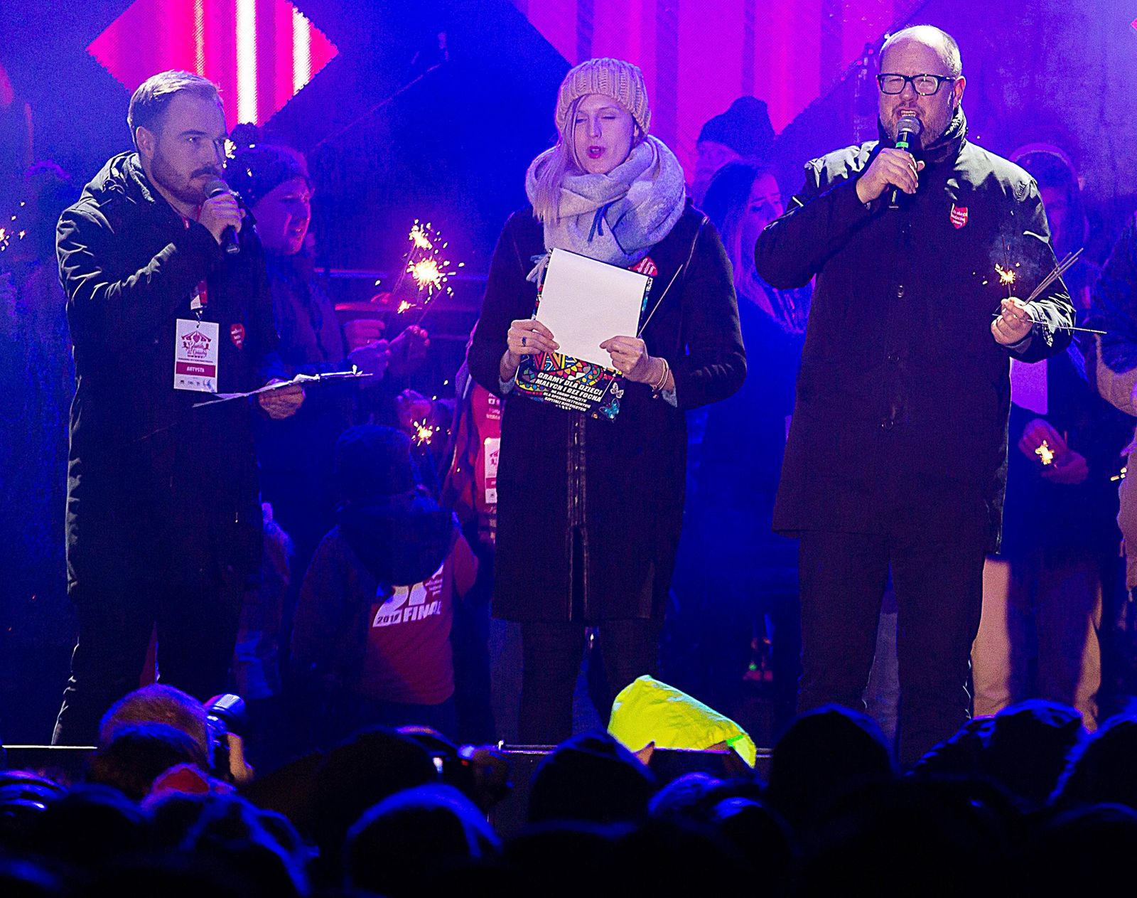 Gdansk Mayor Pawel Adamowicz,right, far right, speaks to an audience shortly before he was stabbed in Gdansk, Poland, on Sunday Jan. 13, 2019. Adamowicz was taken to a hospital in very serious condition after the attack and underwent surgery.   (AP Photo/Anna Rezulak/KFP) POLAND AUT