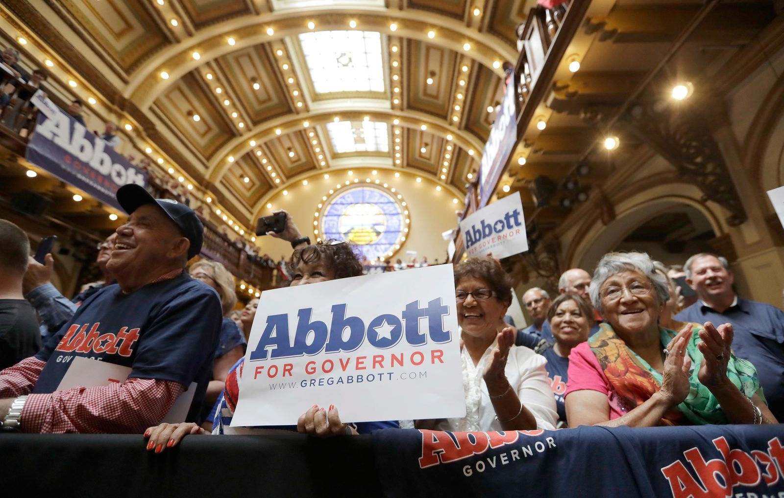 Supporters of Texas Gov. Greg Abbott attend an event where Abbott announced his bid for re-election, Friday, July 14, 2017, in San Antonio. (AP Photo/Eric Gay)