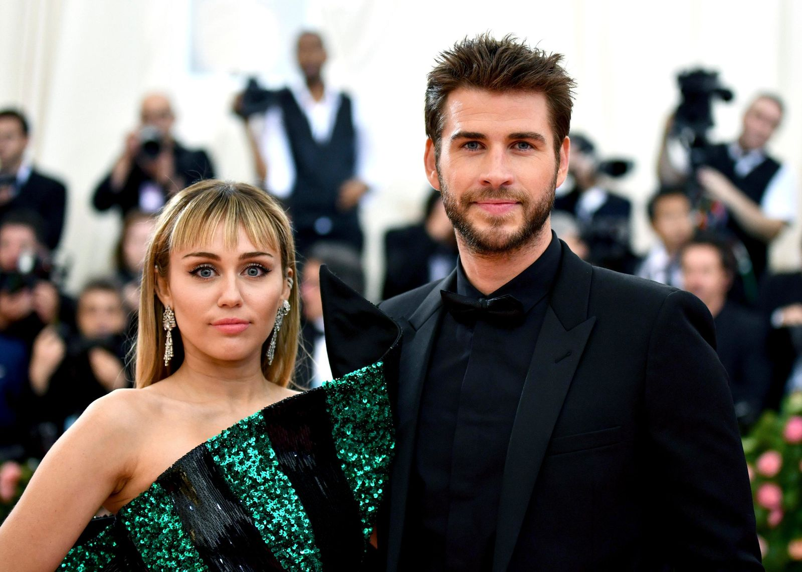 "FILE - In this May 6, 2019 file photo, Miley Cyrus, left, and Liam Hemsworth attend The Metropolitan Museum of Art's Costume Institute benefit gala celebrating the opening of the ""Camp: Notes on Fashion"" exhibition in New York. (Photo by Charles Sykes/Invision/AP, File)"