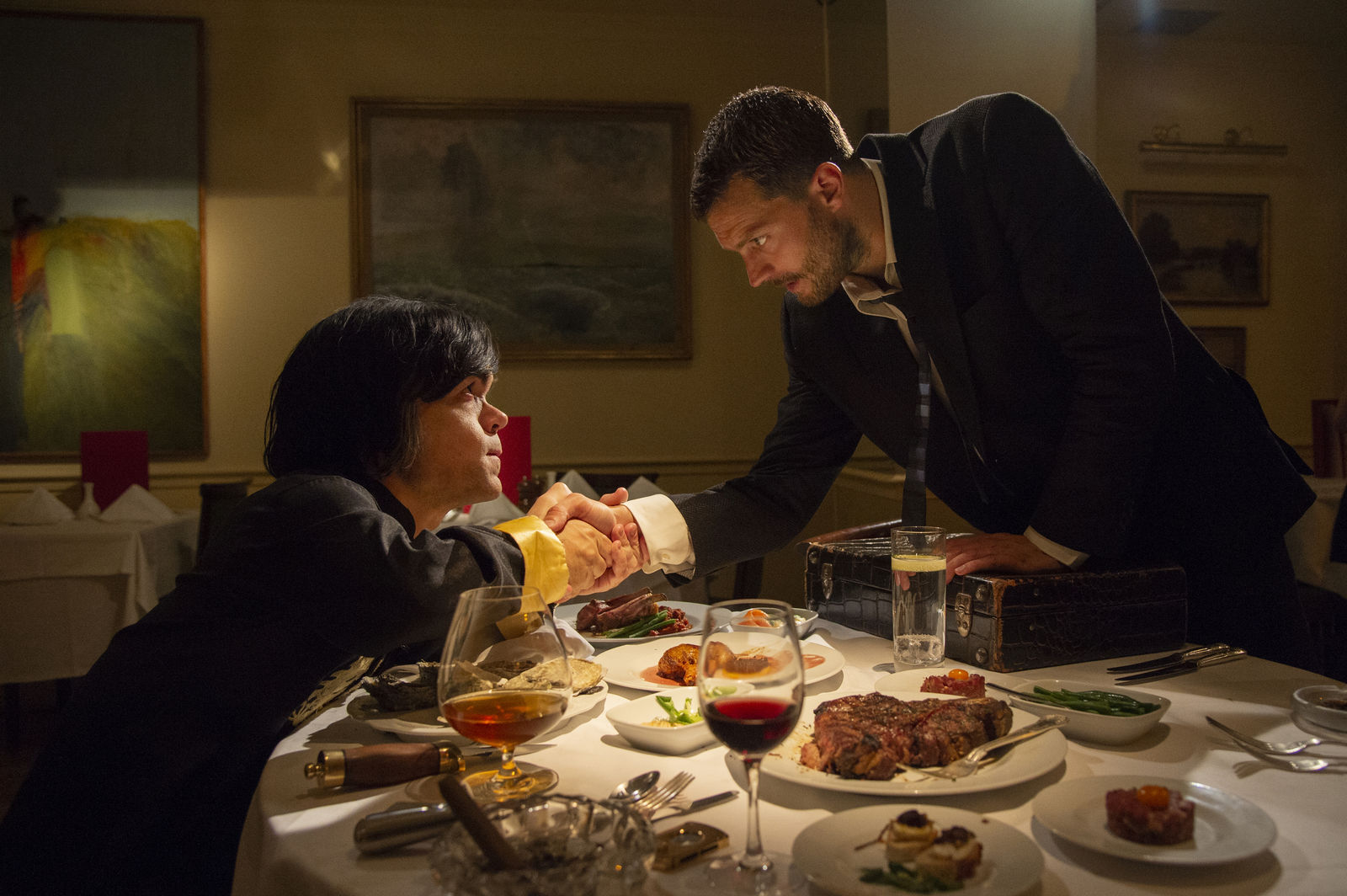 "This image released by HBO shows Peter Dinklage, left, and Jamie Dornan in a scene from ""My Dinner with Herve."" On Tuesday, July 16, 2019, the program was nominated for an Emmy Award for outstanding TV movie. (Steffan Hill/HBO via AP)"