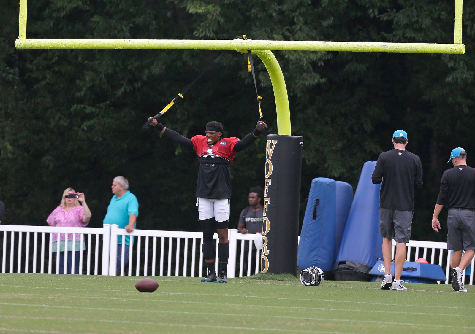 Carolina Panthers' Cam Newton (1) stretches during practice at the NFL team's football training camp at Wofford College in Spartanburg, S.C., Wednesday, Aug. 2, 2017. (AP Photo/Chuck Burton)