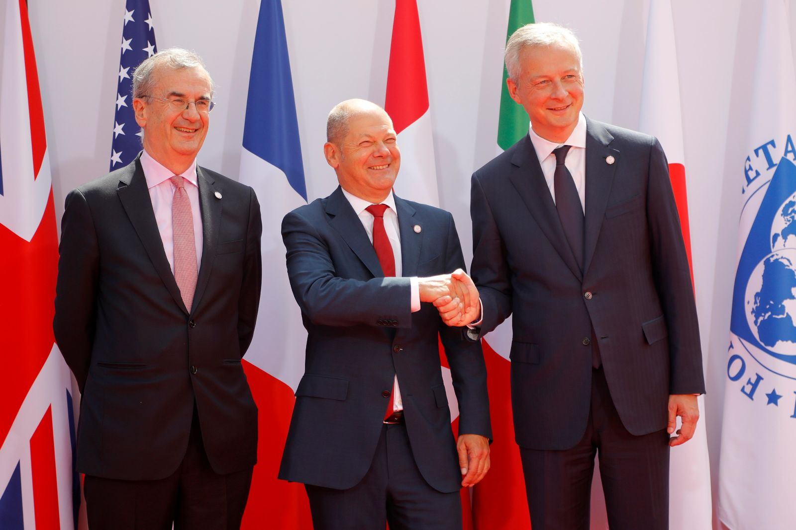 French Finance Minister Bruno Le Maire, right, welcomes German Finance Minister Olaf Scholz, center, with Governor of the Bank of France Francois Villeroy de Galhau, at the G-7 Finance Wednesday July 17, 2019. (AP Photo/Michel Euler)