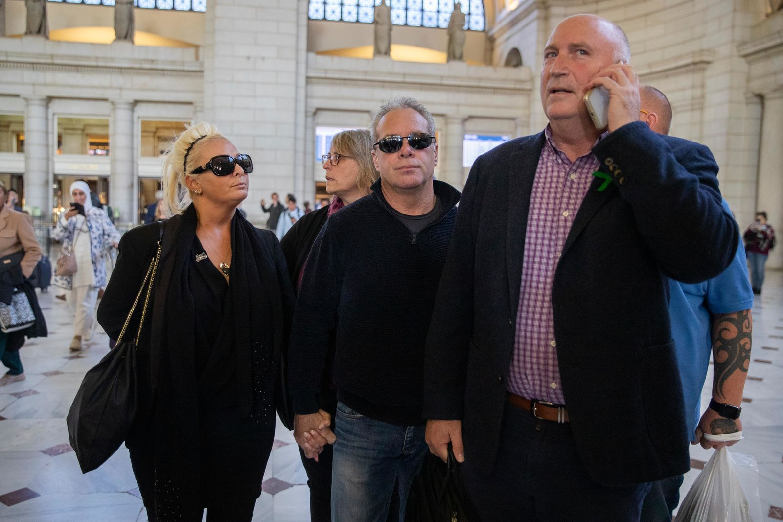 Charlotte Charles, left, mother of British teenager Harry Dunn, and her husband Bruce Charles, center arrive at Union Station in Washington, Tuesday, Oct. 15, 2019. (AP Photo/Manuel Balce Ceneta)