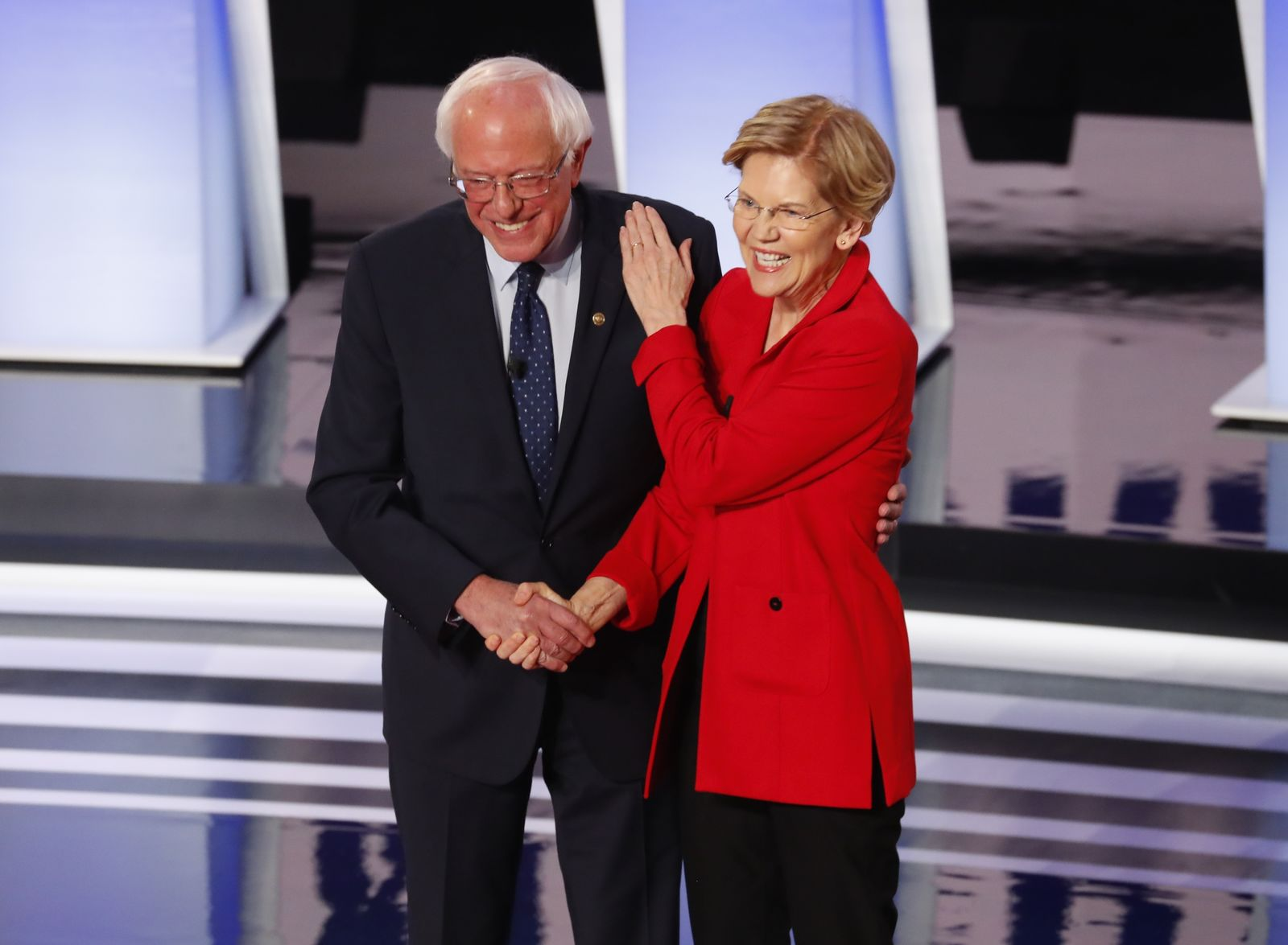 Sen. Bernie Sanders, I-Vt., and Sen. Elizabeth Warren, D-Mass., greet each other before the first of two Democratic presidential primary debates hosted by CNN Tuesday, July 30, 2019, in the Fox Theatre in Detroit. (AP Photo/Paul Sancya)
