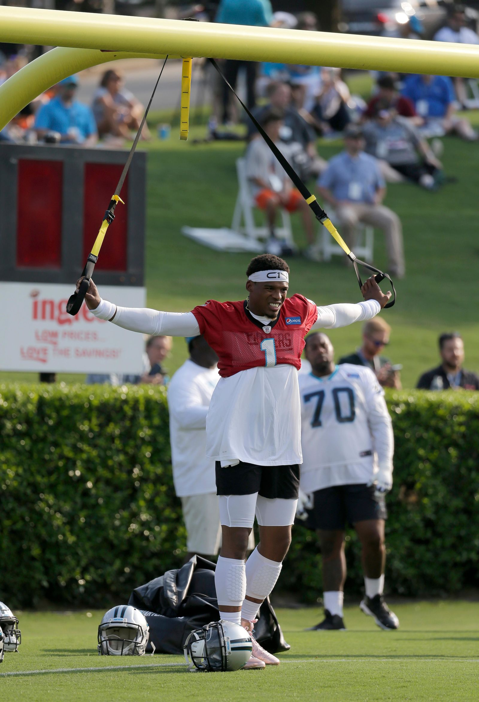 Carolina Panthers' Cam Newton (1) stretches during practice at training camp at Wofford College in Spartanburg, S.C., Wednesday, July 26, 2017. (AP Photo/Chuck Burton)