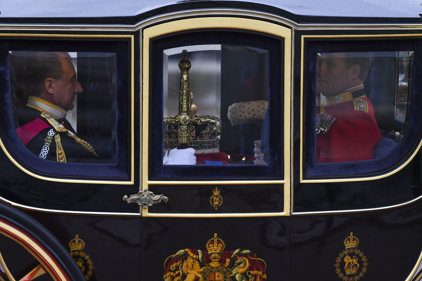 The Imperial State Crown is carried to parliament by carriage ahead of the State Opening of Parliament ceremony in London, Monday, Oct. 14, 2019. (AP Photo/Alberto Pezzali)