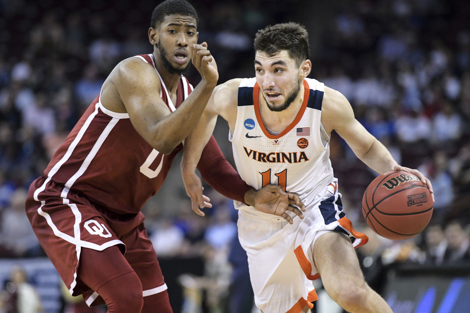 FILE - In this March 24, 2019, file photo, Virginia guard Ty Jerome (11) dribbles the ball as Oklahoma guard Christian James defends during the second half of a second-round game in the NCAA men's college basketball tournament in Columbia, S.C. Jerome could go in the first round of Thursday's NBA draft and play either guard position. (AP Photo/Sean Rayford, File)