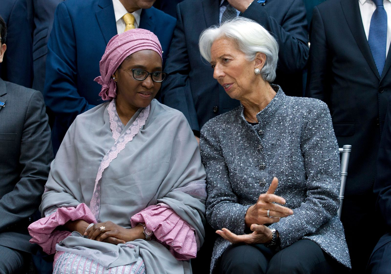International Monetary Fund (IMF) Managing Director Christine Lagarde speaks with Nigeria's Finance Minister Zainab Ahmed, during the International Monetary Fund IMF Governors group photo at the World Bank/IMF Spring Meetings in Washington, Saturday, April 13, 2019. (AP Photo/Jose Luis Magana)