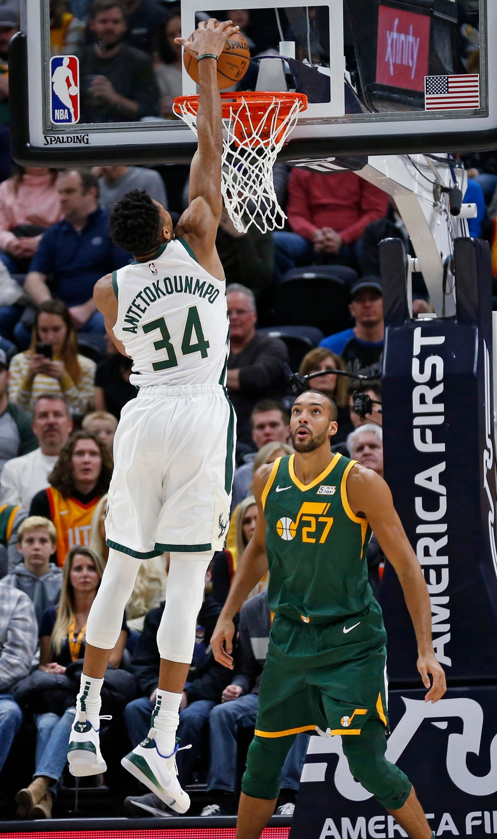Milwaukee Bucks forward Giannis Antetokounmpo (34) dunks in front of Utah Jazz center Rudy Gobert (27) during the first half during an NBA basketball game Saturday, March 2, 2019, in Salt Lake City. (AP Photo/Rick Bowmer)