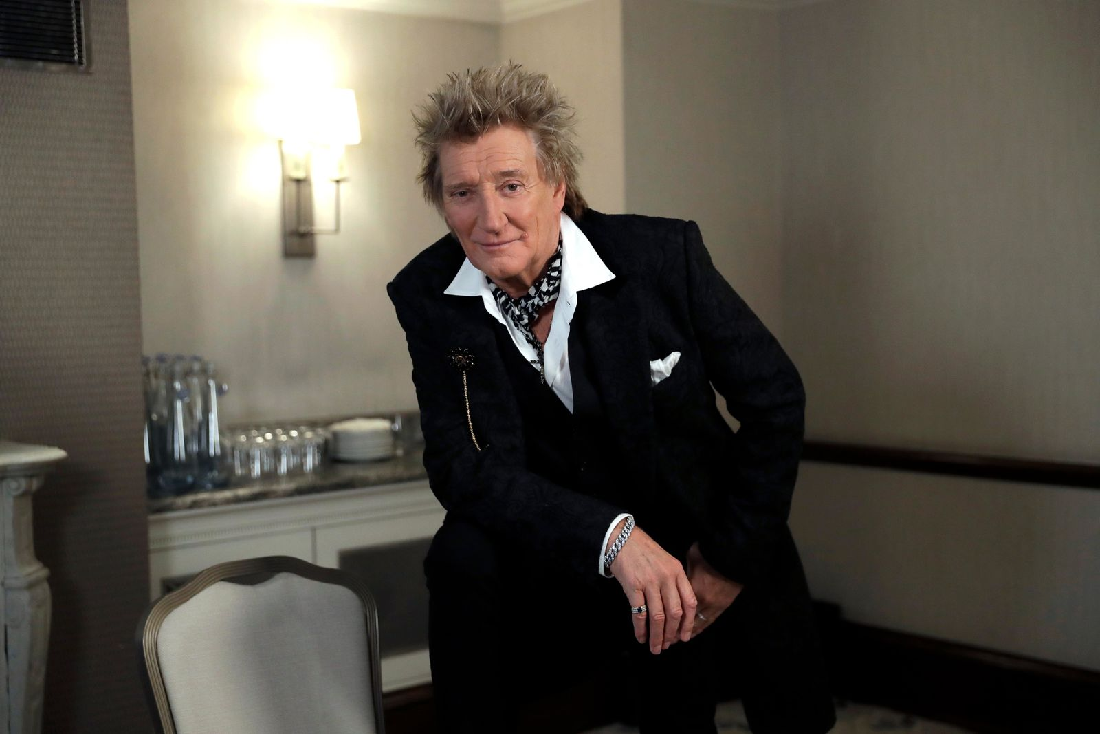 In this photo taken on Thursday, Nov. 14, 2019, British singer Rod Stewart poses for the media after an interview with The Associated Press at a hotel in London. Stewart, known for decades as a consummate crooner, rocker, fashion plate and tongue-in-cheek sex symbol, is adding a new element to his image: serious model railroad builder. The one time front man of The Faces who has hits dating back to the 1960s has put the finishing touch on a 23-year project that has landed him on the cover of Railway Modeller magazine, a far cry from Rolling Stone, whose cover he has graced many times. (AP Photo/Matt Dunham)