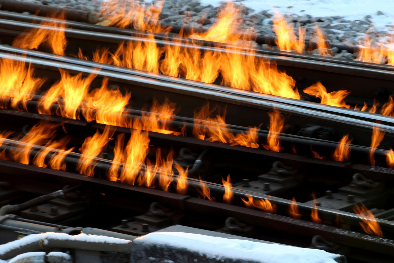 "Burning railroad tracks set afire by railroad workers to heat up the switches and tracks for the winter's frigid temperatures and to keep the trains moving along at 420 N. Artesian in Chicago, Tuesday, Nov. 12, 2019. The National Weather Service says Tuesday and Wednesday may see record cold from the southern Plains to the Mississippi Valley to the Great Lakes and beyond, thanks to what it calls an ""arctic airmass.""(Antonio Perez/Chicago Tribune via AP)"