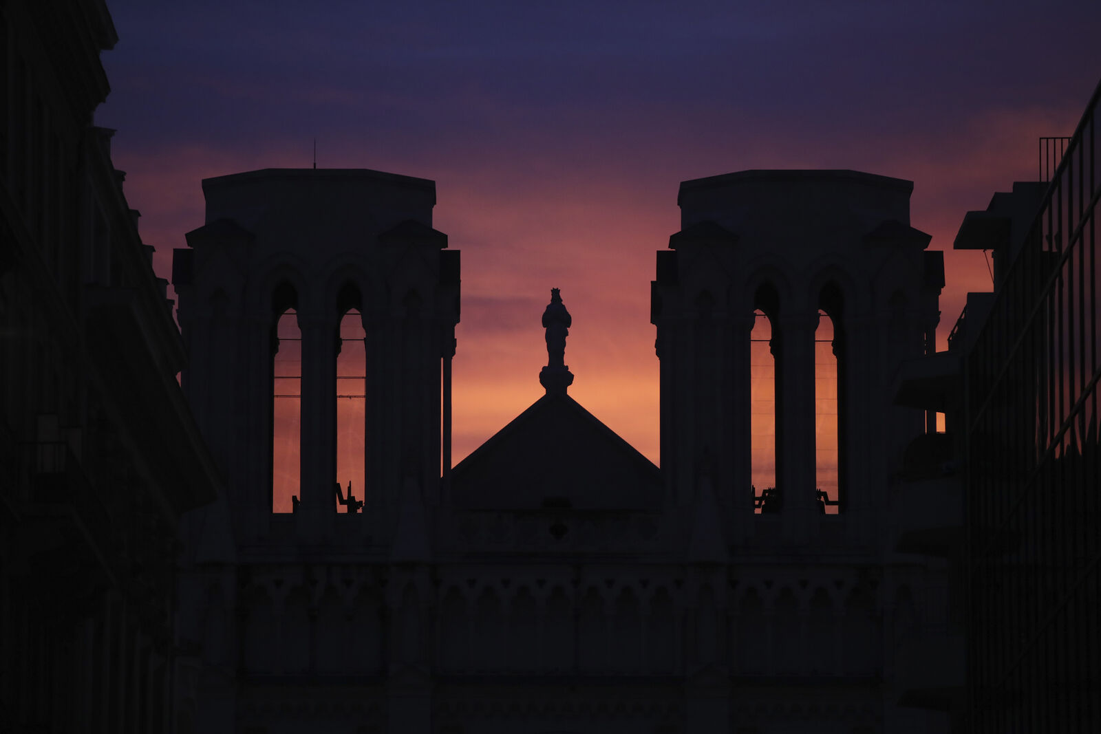 FILE- The sun sets behind the Notre Dame church in Nice, southern France, after a knife attack took place on Thursday, Oct. 29, 2020.{ } (AP Photo/Daniel Cole)