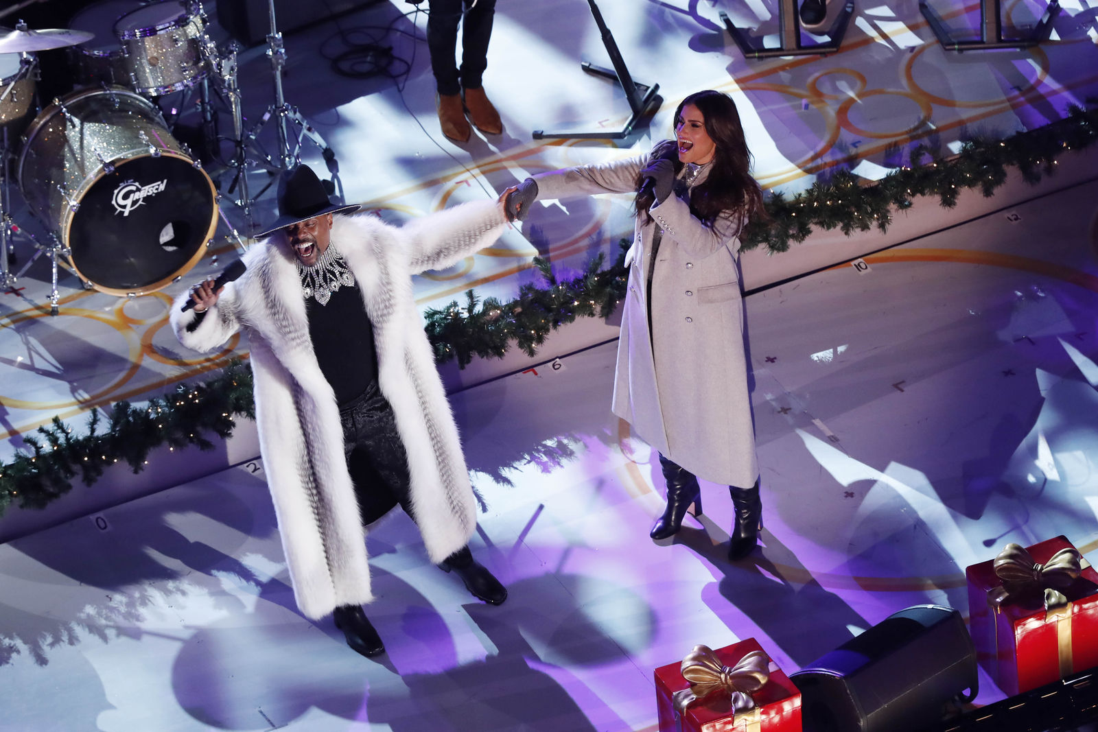 Billy Porter, left, and Idina Menzel perform during the 87th annual Rockefeller Center Christmas Tree lighting ceremony, Wednesday, Dec. 4, 2019, in New York. (AP Photo/Kathy Willens)