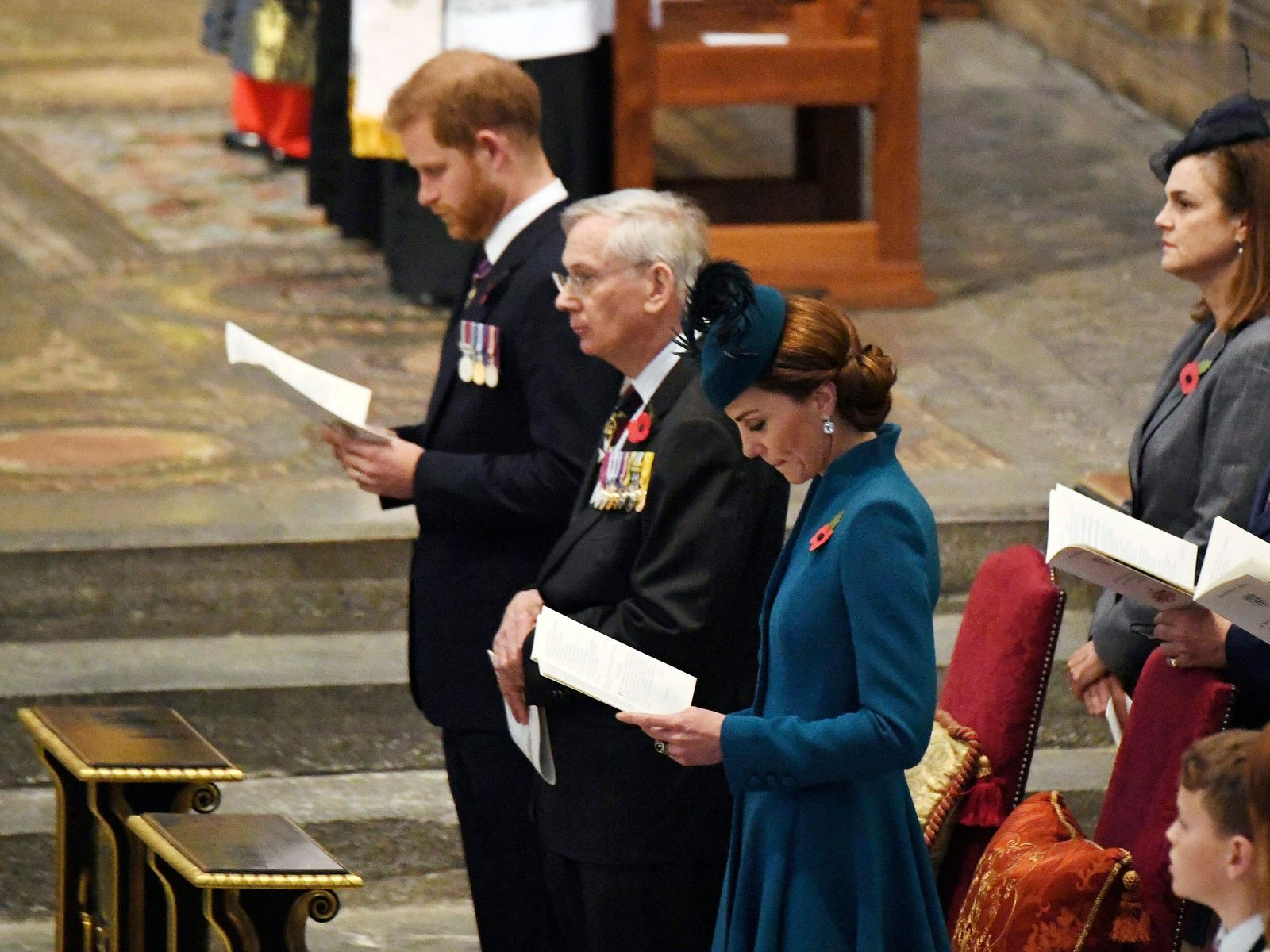 Kate, the Duchess of Cambridge, centre,  Prince Harry, the Duke of Sussex background centre and the Duke of Gloucester attend the Anzac Day Service of Commemoration and Thanksgiving at Westminster Abbey, in London, Thursday April 25, 2019.{ } { }(Victoria Jones/Pool Photo via AP)