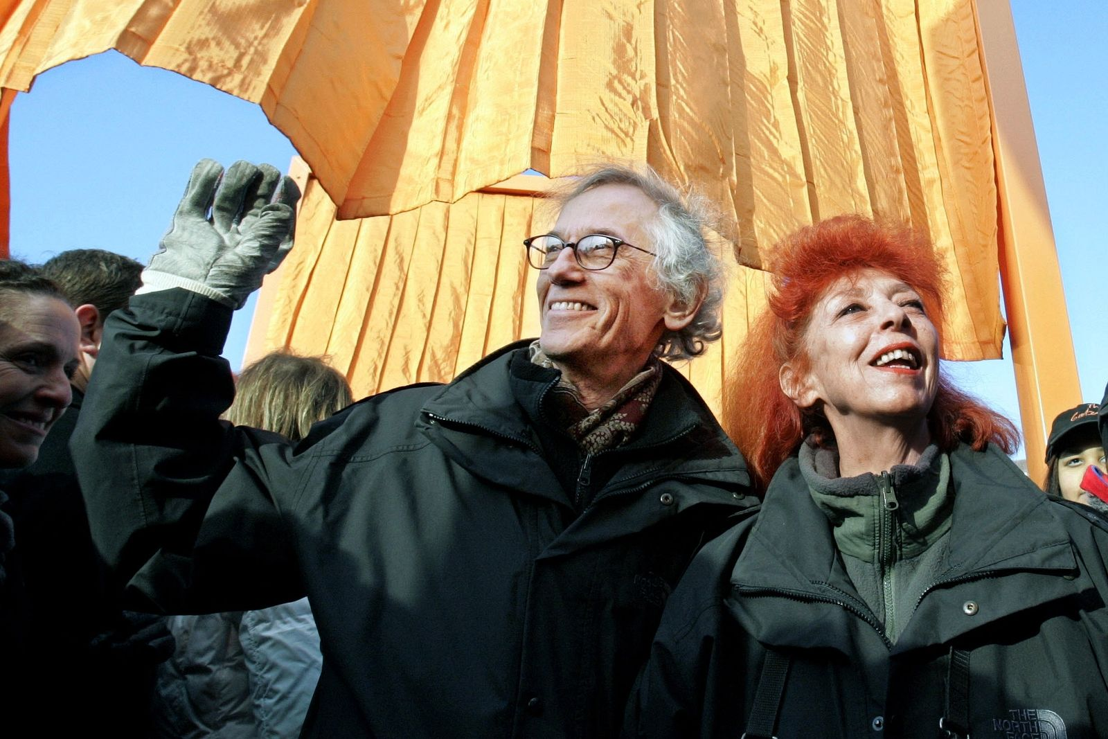 "FILE - In this file photo of Feb. 12, 2005, artists Christo, left, and his wife and partner Jeanne-Claude, participate in opening ""The Gates"" project in New York's Central Park. (AP Photo/Richard Drew, File)"