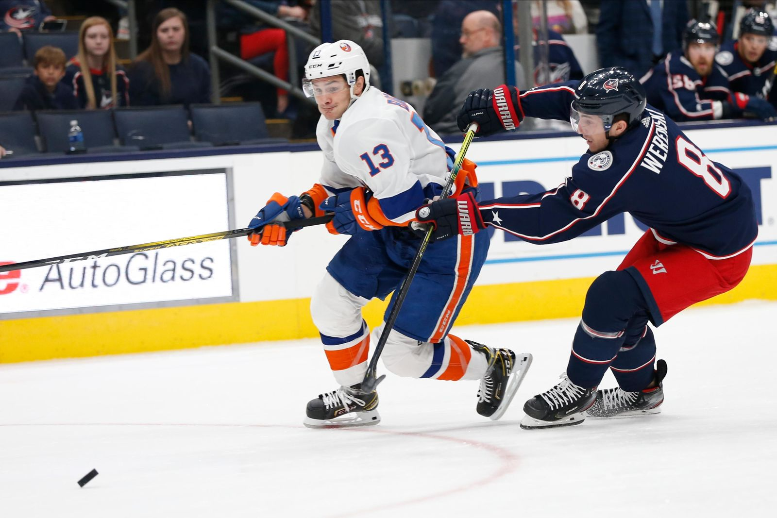 New York Islanders' Mathew Barzal, left, carries the puck up ice as Columbus Blue Jackets' Zach Werenski defends during the first period of an NHL hockey game Saturday, Oct. 19, 2019, in Columbus, Ohio. (AP Photo/Jay LaPrete)