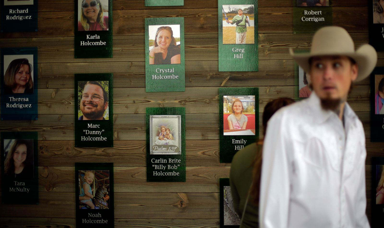 Churchgoers pass a memorial wall following a dedication ceremony for a new sanctuary and memorial room at the First Baptist Church in Sutherland Springs, Texas, Sunday, May 19, 2019. In 2017 a gunman opened fire at the church and killed more than two dozen congregants. (AP Photo/Eric Gay)