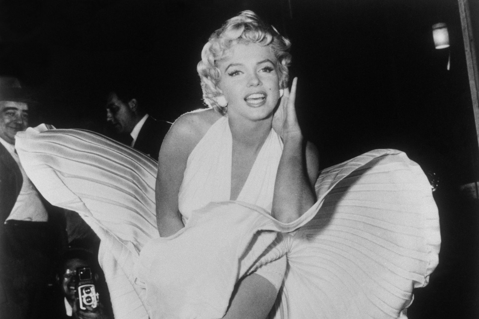 "FILE - In this Sept. 9, 1954 file photo, Marilyn Monroe poses over the updraft of a New York subway grate while filming ""The Seven Year Itch"" New York. (AP Photo/Matty Zimmerman, File)"