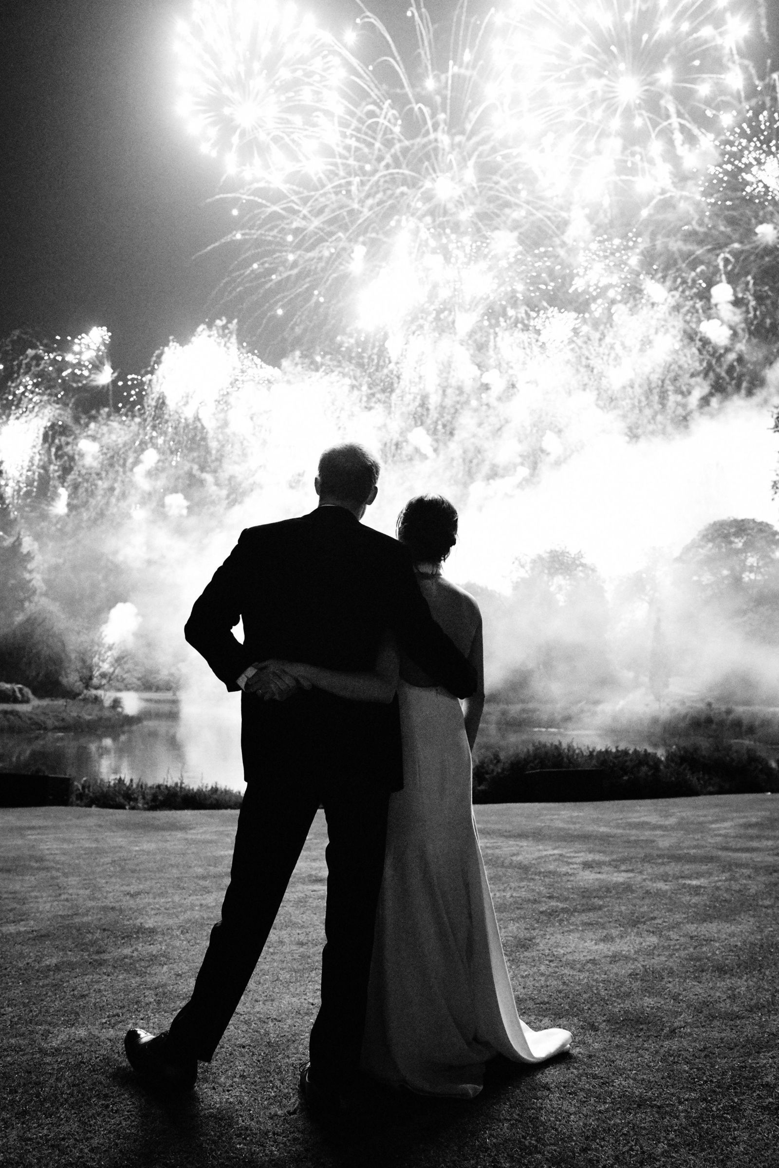 This photo released by Kensington Palace on Friday Dec. 14, 2018, shows the photo taken by Chris Allerton of Britain's Prince Harry and Meghan, Duchess of Sussex at their wedding reception at Frogmore House, Windsor, England. (Chris Allerton/Kensington Palace via AP)