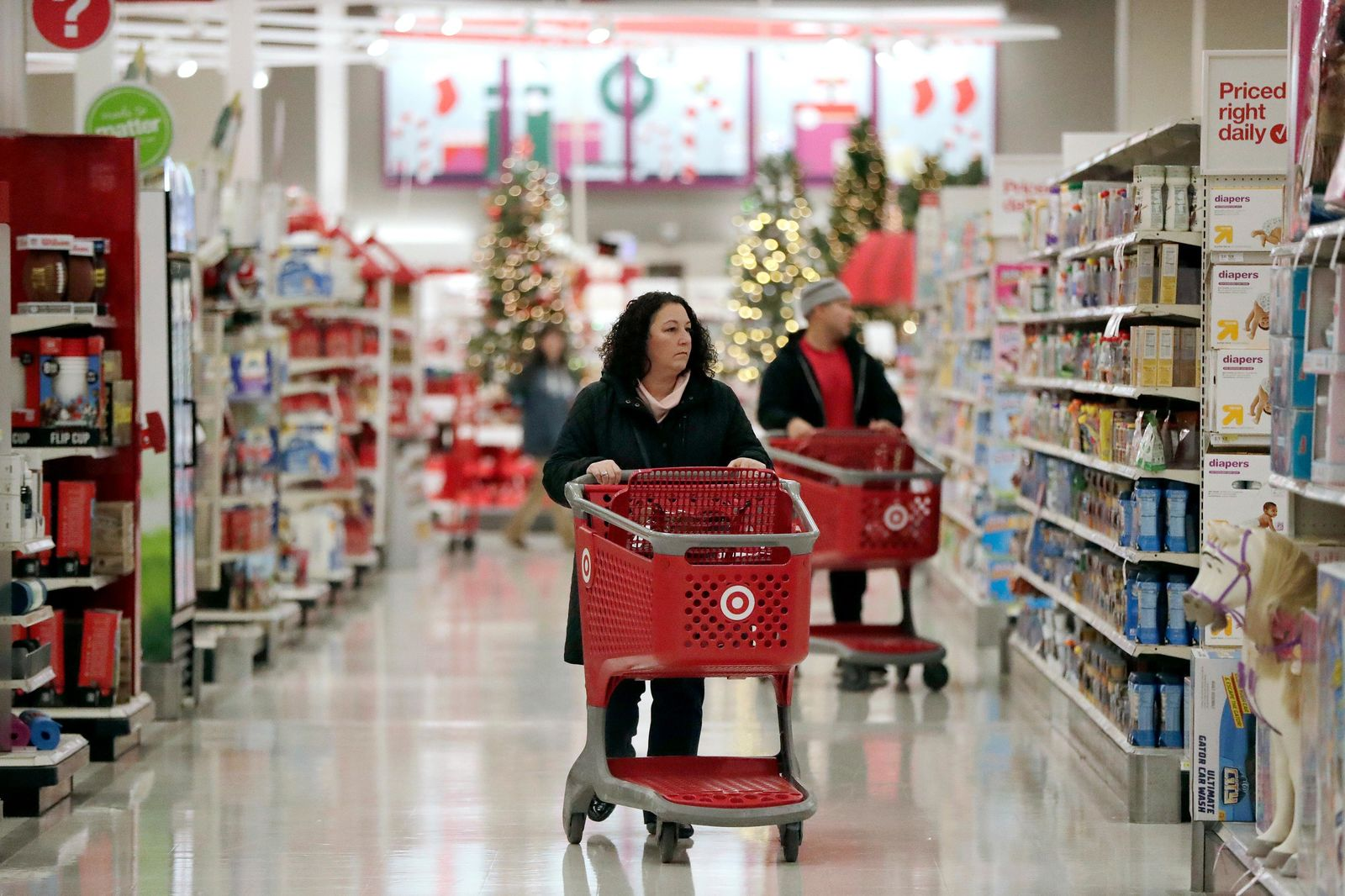 In this Friday, Nov. 16, 2018, file photo, shoppers push carts while browsing isles at a Target store in Edison, N.J.{ } (AP Photo/Julio Cortez, File)
