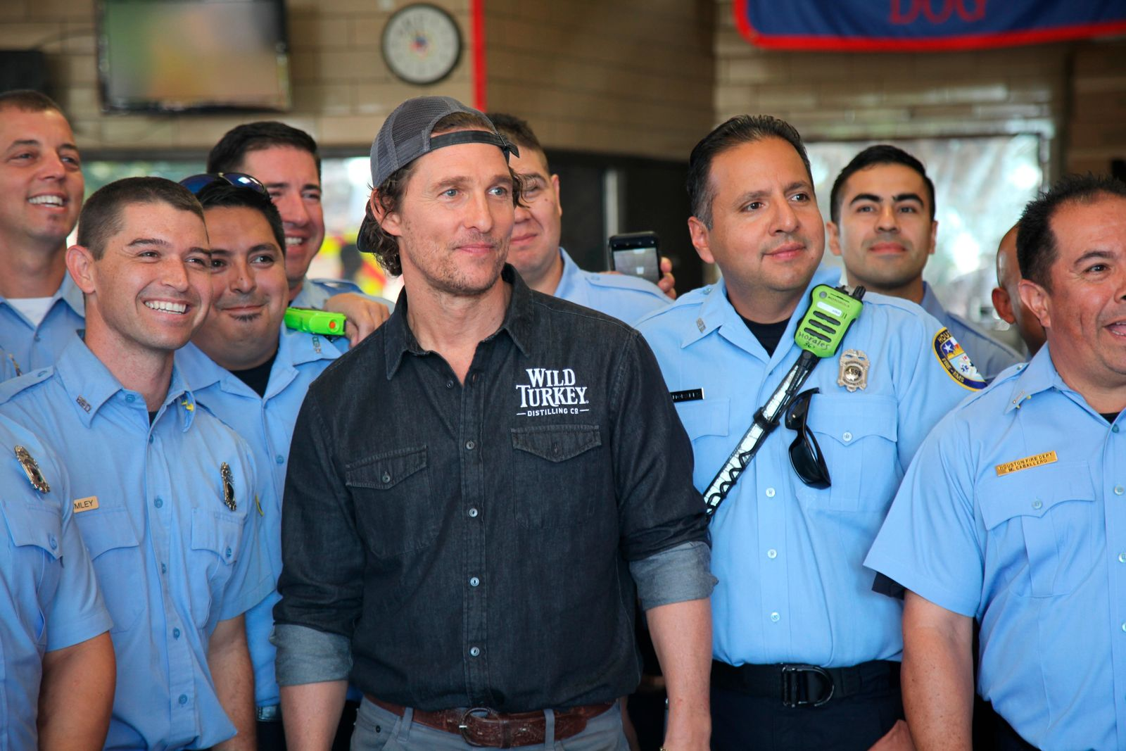 This Oct. 28, 2018 photo shows actor Matthew McConaughey posing with first responders in Houston as he  surprised them with catered lunches. (AP Photo/John Mone)