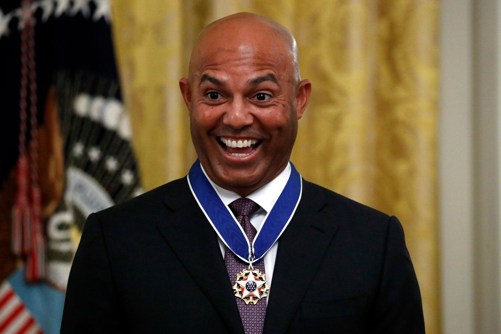 Former New York Yankees baseball pitcher Mariano Rivera smiles after being presented the Presidential Medal of Freedom by President Donald Trump in the East Room of the White House, Monday, Sept. 16, 2019, in Washington. (AP Photo/Patrick Semansky)