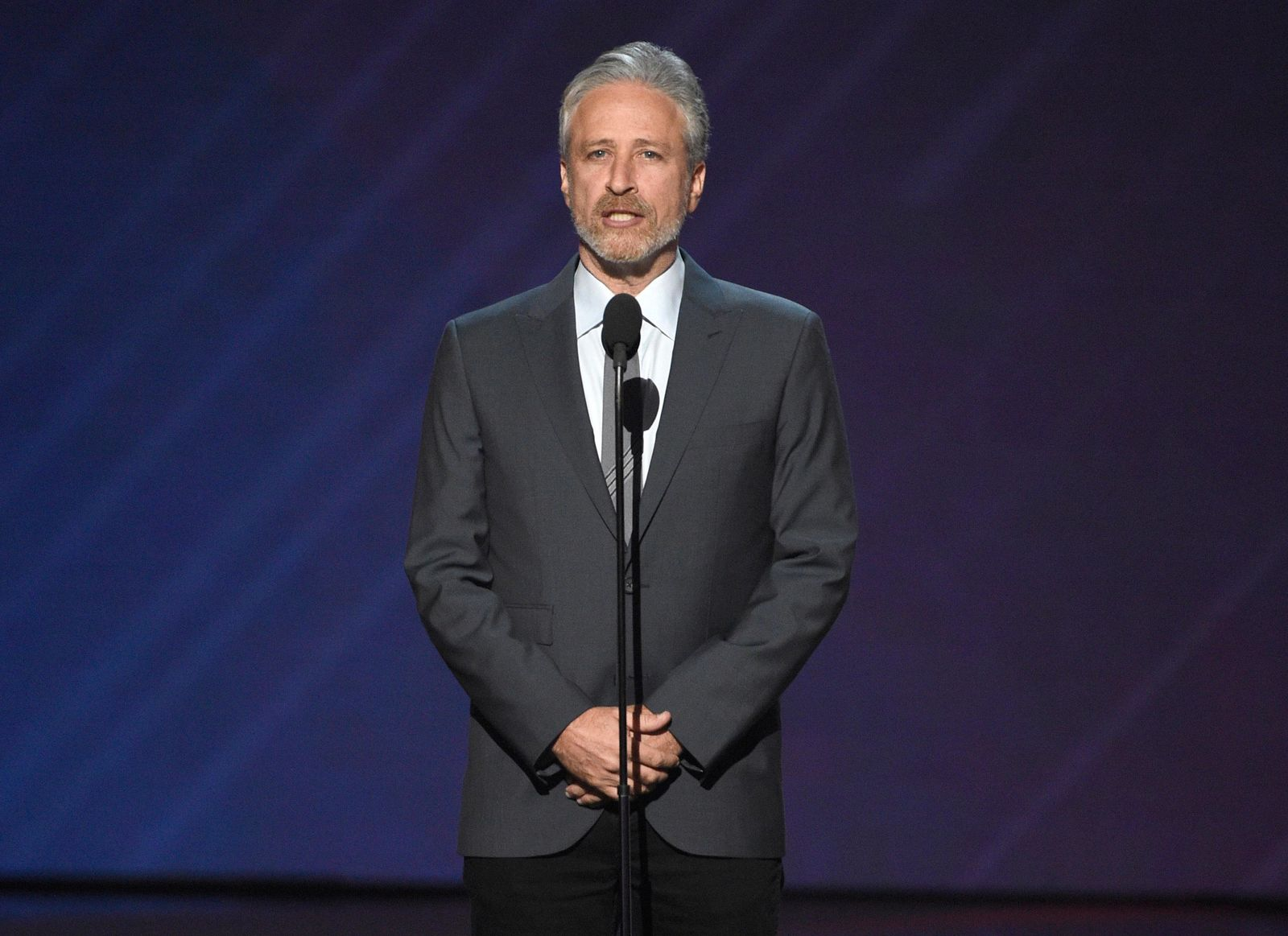 FILE- In this July 12, 2017, file photo, Jon Stewart presents the Pat Tillman award for service at the ESPYS at the Microsoft Theater in Los Angeles. (Photo by Chris Pizzello/Invision/AP, File)