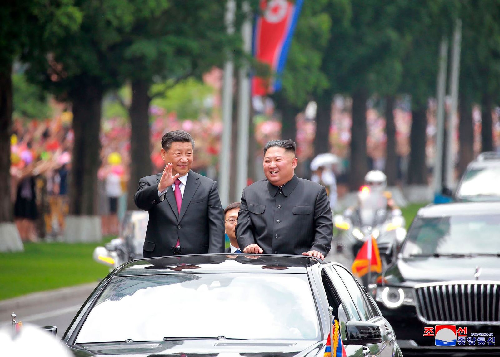 "In this Thursday, June 20, 2019, photo provided by the North Korean government, North Korean leader Kim Jong Un, right, and Chinese President Xi Jinping acknowledge welcoming people from the limousine in Pyongyang, North Korea. The content of this image is as provided and cannot be independently verified. Korean language watermark on image as provided by source reads: ""KCNA"" which is the abbreviation for Korean Central News Agency. (Korean Central News Agency/Korea News Service via AP)"