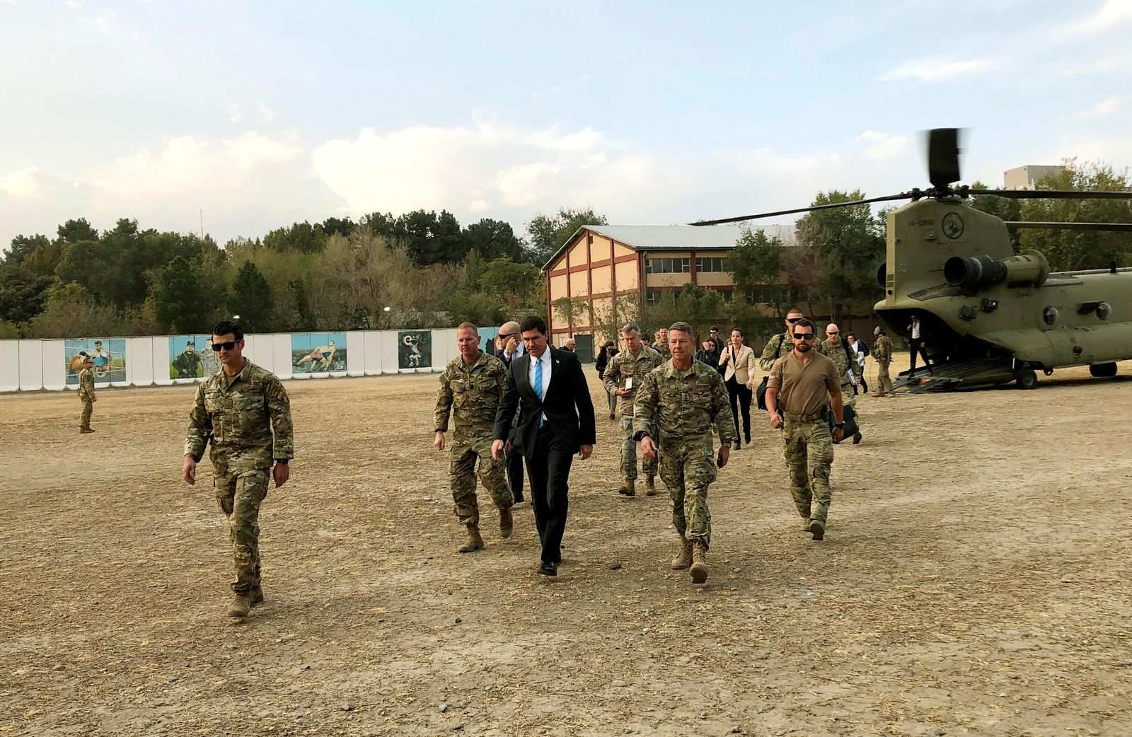 U.S. Defense Secretary Mark Esper, center, walks Gen. Scott Miller, right, chief of the U.S.-led coalition in Afghanistan, at the U.S. military headquarters in Kabul, Afghanistan, Sunday, Oct. 20, 2019. (AP Photo/Lolita C. Balbor)