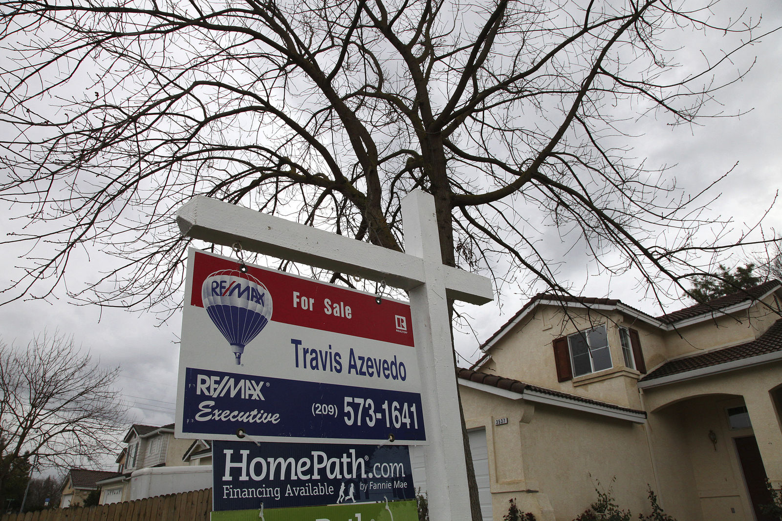 FILE -- In this Feb. 29. 2012 file photo a for sale sign is seen on the lawn of a foreclosed home in Stockton, Calif. (AP Photo/Ben Margot, File)